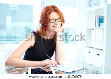Portrait of a smiling smart-looking lady in little black dress