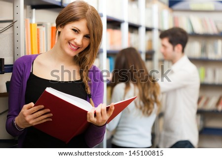 Portrait of a smiling student - stock photo
