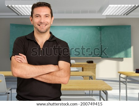 Portrait of a smiling teacher in an empty classroom