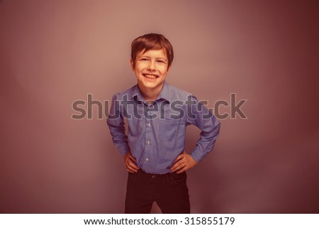 portrait of a smiling teenage boy  of European appearance retro