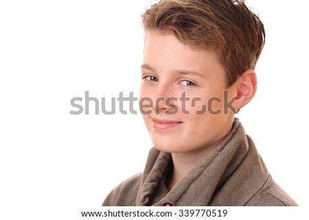 Portrait of a smiling teenage boy on white background - stock photo