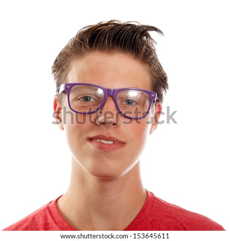 Portrait of a smiling teenager with large glasses on a white background - stock photo