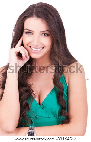 Portrait of a smiling thinking woman looking to the camera - isolated on white - stock photo