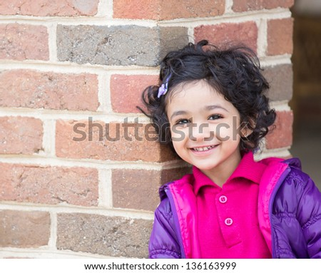Portrait of a Smiling Toddler Girl - stock photo