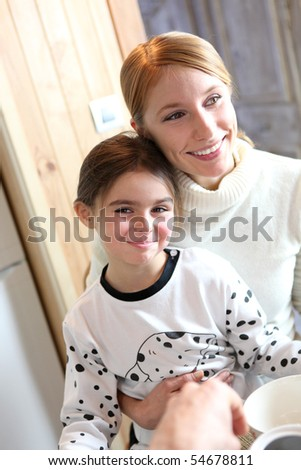 Portrait of a smiling woman and a little girl in pajamas