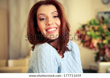 Portrait of a smiling woman at home
