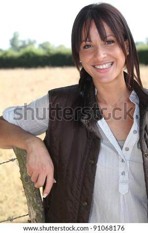 Portrait of a smiling woman farmer - stock photo