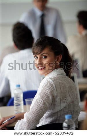 portrait of a smiling woman in a training room - stock photo