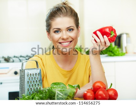 Portrait of a Smiling woman in kitchen. - stock photo