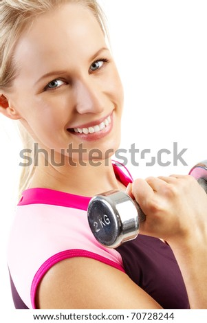Portrait of a smiling woman with a dumbbell - stock photo