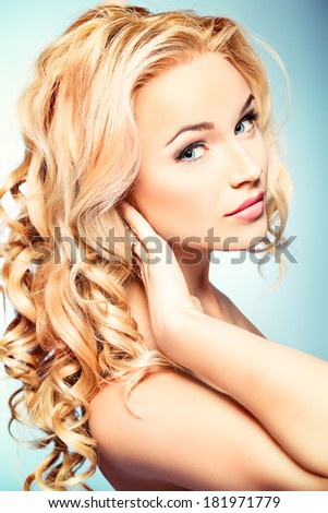 Portrait of a smiling woman with beautiful blonde hair. Hair care. Beauty, fashion. - stock photo