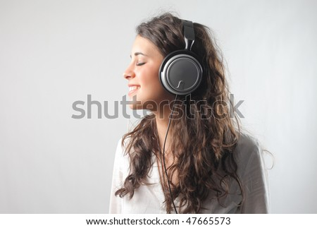 Portrait of a smiling woman with headphones - stock photo