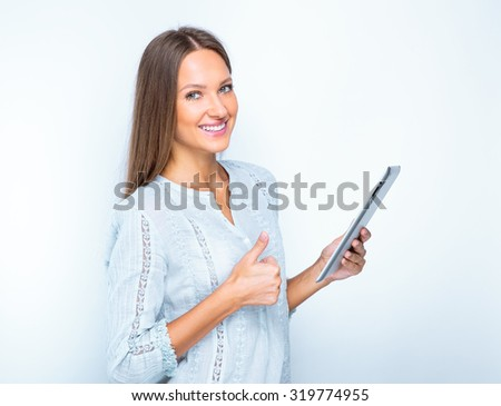 portrait of a smiling woman with tablet. isolated on white. beautiful girl using tablet computer. - stock photo