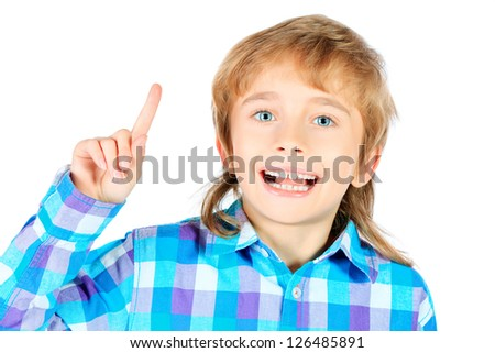 Portrait of a smiling 9 year boy draws attention to something. Isolated over white background.
