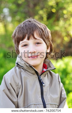 Portrait of a smiling 7-year old boy - stock photo
