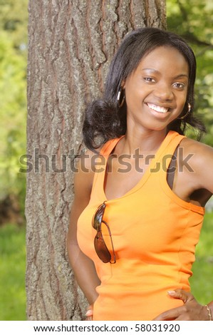 portrait of a smiling yong african lady in natural environment