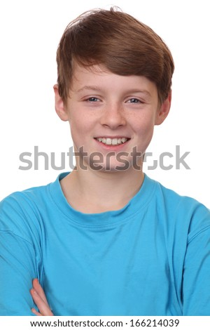 Portrait of a smiling young boy on white background - stock photo