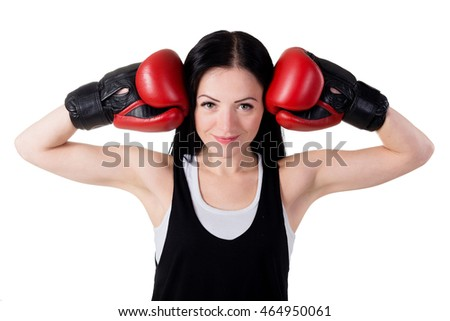 Portrait of a smiling young brunette girl with red boxing gloves. Isolated on white background in studio
