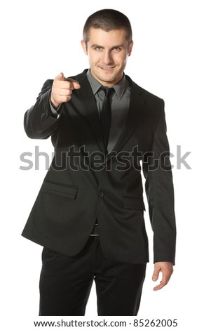 Portrait of a smiling young business man pointing at you over white background - stock photo