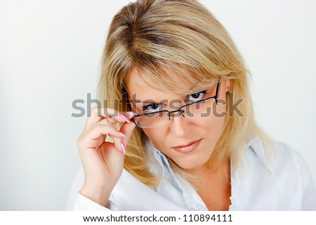portrait of a smiling young business woman in glasses - stock photo