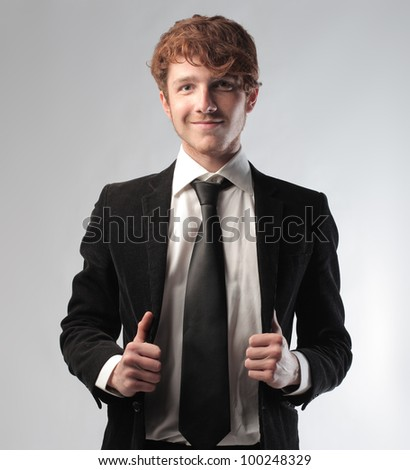 Portrait of a smiling young businessman - stock photo