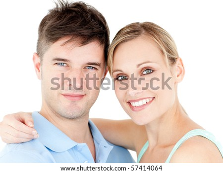 Portrait of a smiling young couple against white background - stock photo