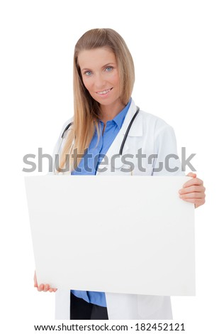 Portrait of a  smiling young Doctor holding a blank sheet of paper on white to write your text. Isolated on a white background. Copy space. - stock photo