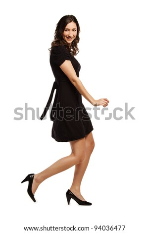 Portrait of a smiling young girl walking on white background - stock photo