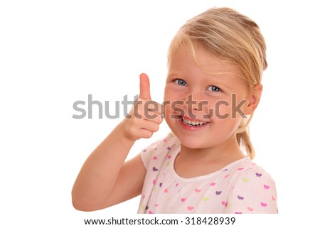 Portrait of a smiling young girl with thumbs up on white background - stock photo