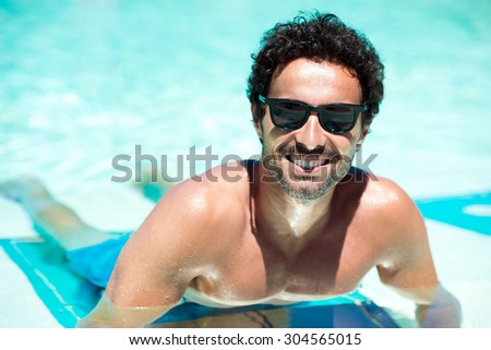 Portrait of a smiling young man relaxing in the water