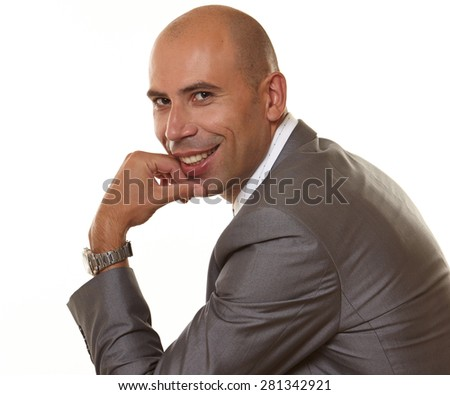 portrait of a smiling  young man with  he leans his chin on his left  hand with  watches,  he dressed in at gray suit on the white background.   He looks a little bit like President Obama  - stock photo
