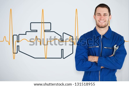 Portrait of a smiling young mechanic next to background with car engine and heart line - stock photo