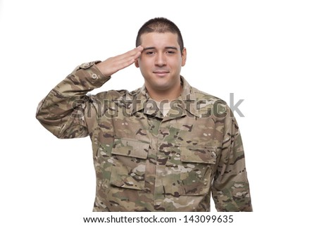 Portrait of a smiling young soldier saluting  - stock photo
