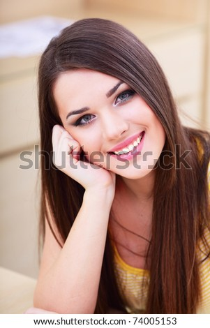 Portrait of a smiling young woman at home - stock photo