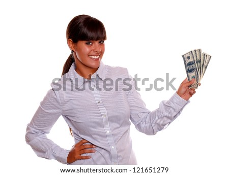 Portrait of a smiling young woman holding cash money standing over white background - stock photo