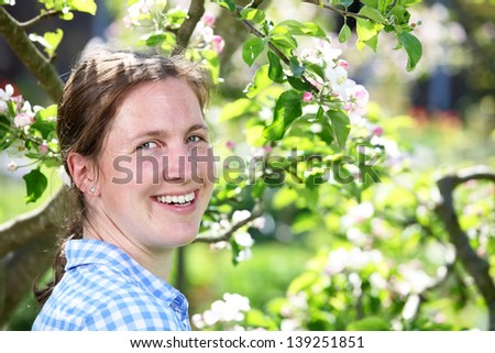 Portrait of a smiling young woman in the garden