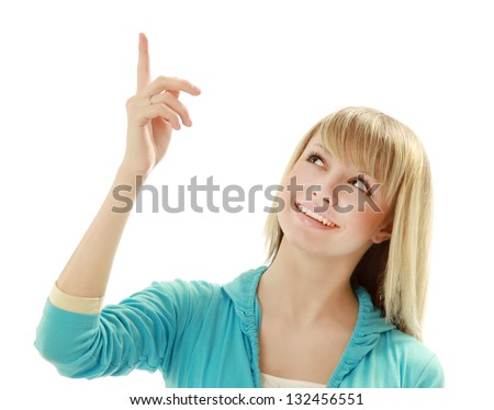 Portrait of a smiling young woman pointing up, isolated on white background - stock photo
