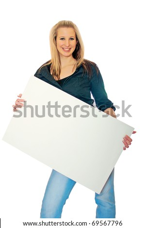 Portrait of a smiling young woman with blank bill board over white background - stock photo