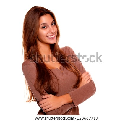 Portrait of a smiling young woman with long brown hair looking at you on isolated background
