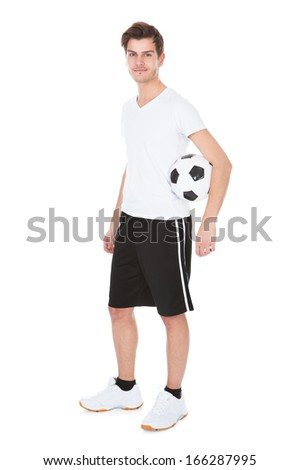 Portrait Of A Soccer Player Holding Football On White Background - stock photo