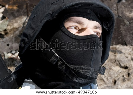Portrait of a soldier in mask and tactical helmet - stock photo