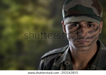 Portrait of a soldier in military uniform - stock photo