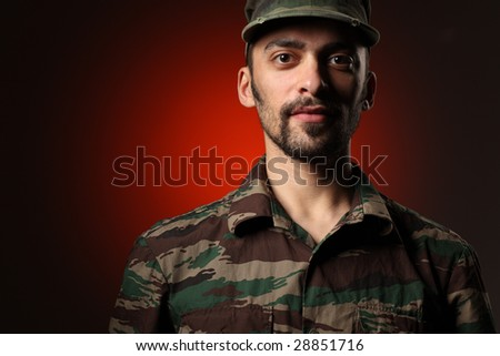 Portrait of a soldier over red and black background