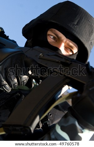 Portrait of a soldier with automatic russian AK47 rifle - stock photo
