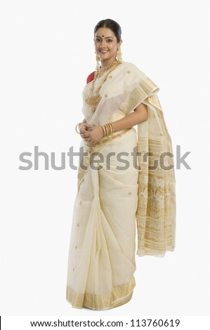 Portrait of a South Indian woman wearing jewelry and sari - stock photo