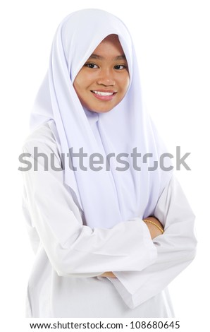 Portrait of a Southeast Asian Muslim teen crossed arms over white background - stock photo