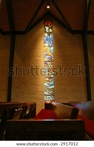 Portrait of a stained glass window inside of a church - stock photo