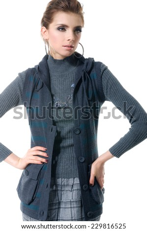 Portrait of a standing young woman posing - stock photo