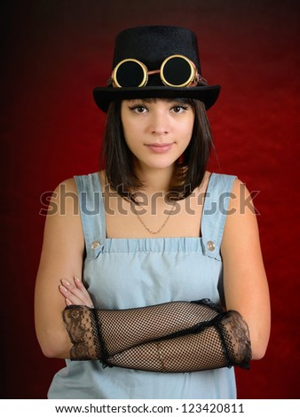 Portrait of a steam punk girl. Looking at camera. - stock photo