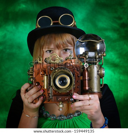 Portrait of a steam punk girl with a camera. - stock photo